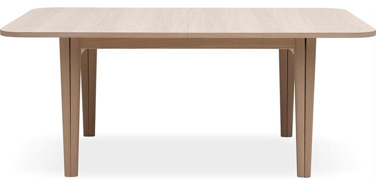 Innovativt spisebord i lyst træ med kreativt udtræk