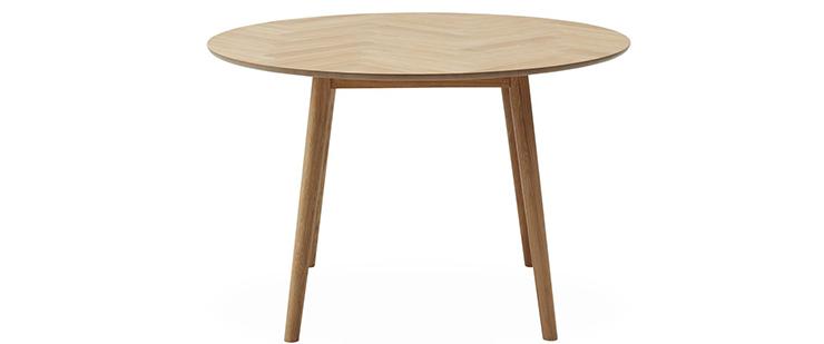 Rundt spisebord bed stillebenet bordplade