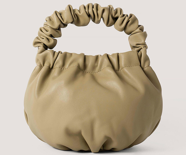 Lille buttet håndtaske i grøn kunstlæde