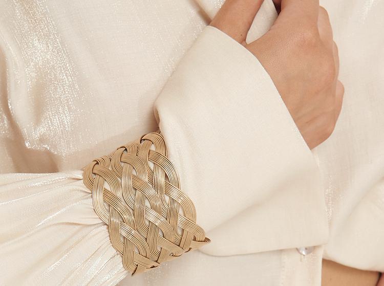 Kraftigt guldarmbånd i flettet design