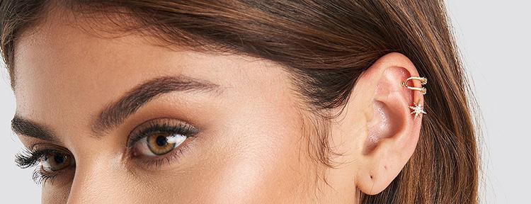 Pakke med fire smukke ear cuffs i guld
