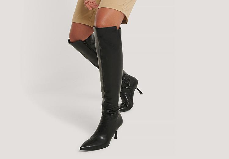 Elegante højtskaftede støvler med tynd hæ