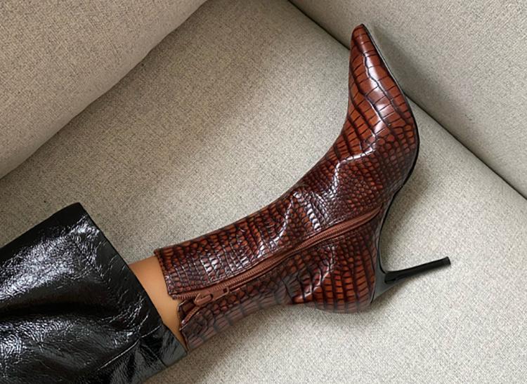 Flotte støvler i kunstigt slangeskind