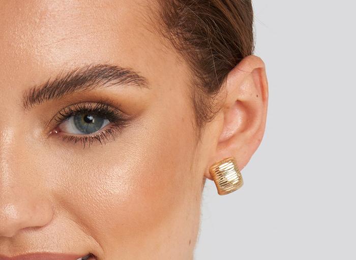 Smykke guld øreringe i kantet design