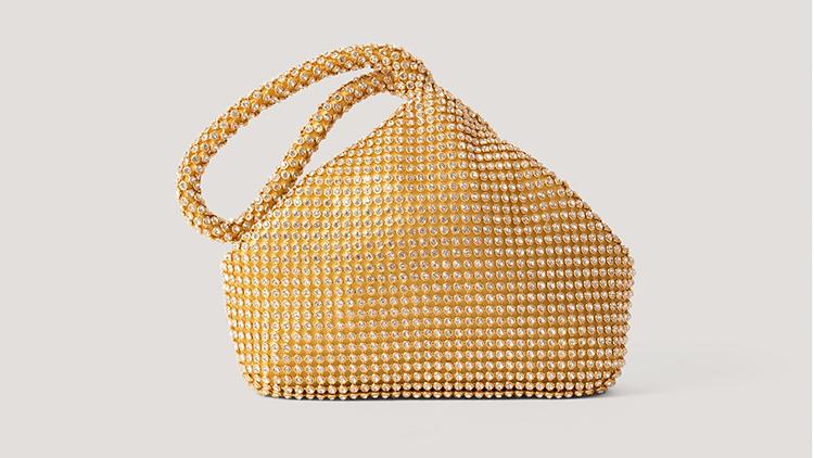 Yndig lille guldtaske
