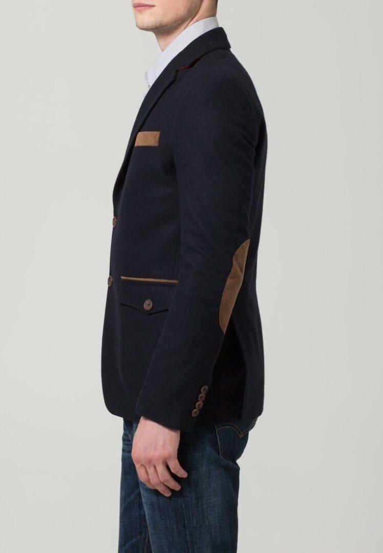 mørkeblå blazer med brune lommer
